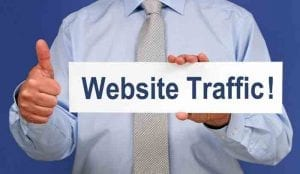 Man holding a sign saying website traffic